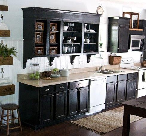 hmmm black cabinets and white tile blacksplash wasn t
