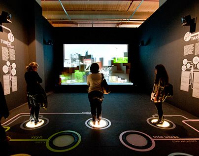 """The goal of this exhibition is to explain the city of istambul without cliches. In the front wall there is an image of Istambul, and on the floor there are some """"buttons"""" related to different areas. By stepping on these buttons, the visitor affects the city in front of him in different ways."""