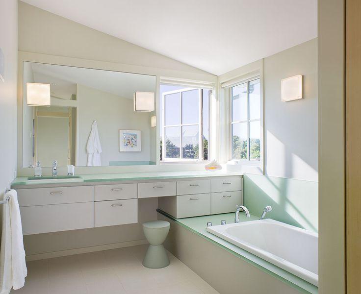 custom built modern style bathroom with sleek bath and light tile floors on cape cod