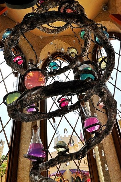 Hanging grapevine swirl with different color potions on. Harry Potter style.