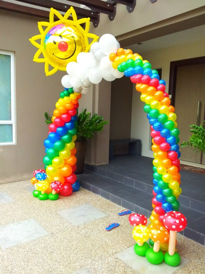 This Rainbow spiral balloon arch will bring