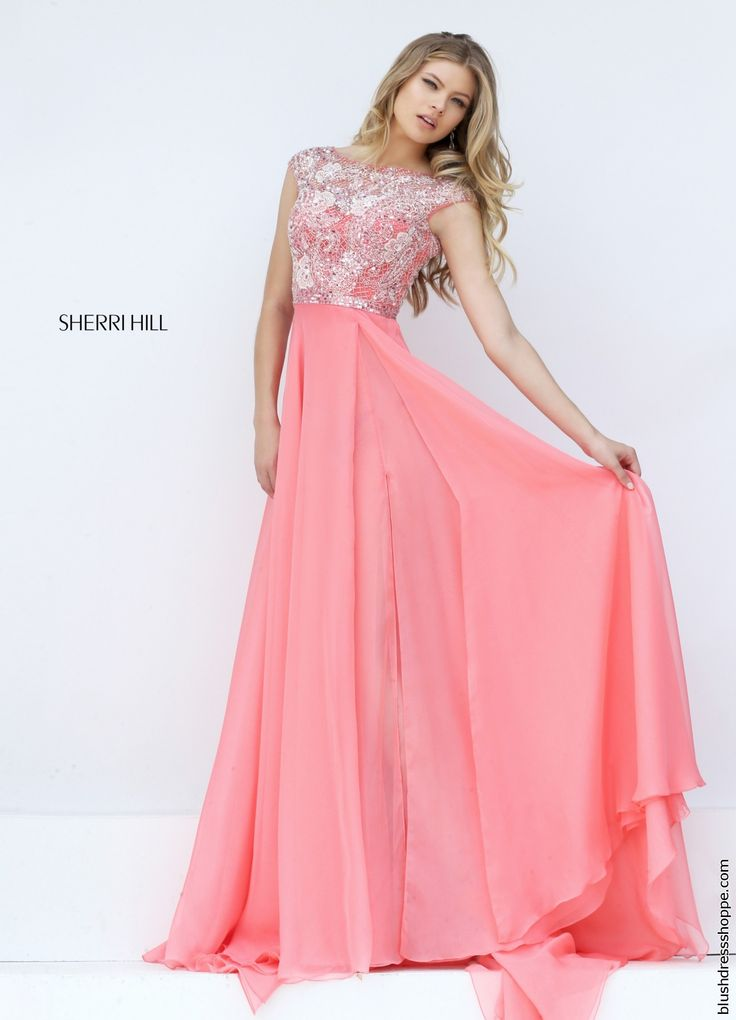 Stunning Sherri Hill prom dress 50445 features a beaded bodice with cap sleeves and flowing chiffon skirt. The bodice is perfectly adorned in immaculate appliques adorned in dazzling bead work so you