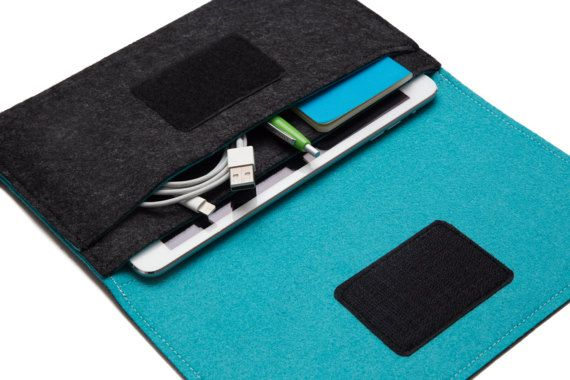 Handmade iPad carrying case - Dark Grey & Turquoise felt. This handmade iPad case was designed to protect your iPad while keeping it fashionably and elegant. It has an inner pocket for additional accessories such as notebooks, cables etc...perfect when you want to travel light. The case fits the iPad with Apples smart cover. If you need it to fit a keyboard as well (Such as Logitech/Apple smart keyboard or other brands) please let me know when ordering (add a note with the brand and...