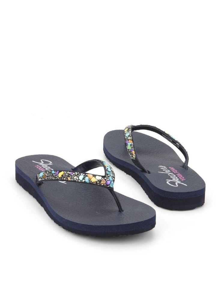 Skechers slipper  Description: Blauwe dames teenslippers van Skechers.  Price: 31.49  Meer informatie