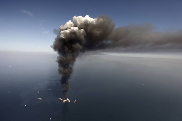 BP Agrees to Pay $18.7 Billion to Settle Deepwater Horizon Oil Spill Claims | Smoke rises from fires on BP's Deepwater Horizon offshore oil rig in April 2010 before...