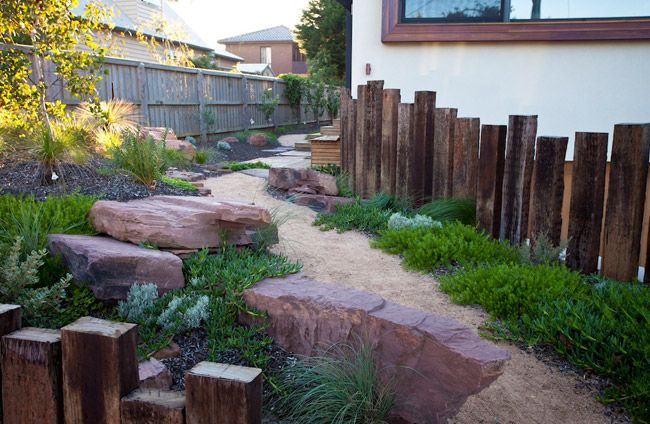 Applying sleepers vertical and at different sizes dramatically improves the effect in a natural bush style garden. Well positioned large rocks adds the next level of charm. Critic by John Dodd. Original text Parkdale, Victoria