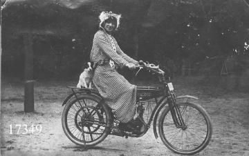 Woman with dog on motorbike by Aalborg Stadsarkiv, photographer unknown (via Flickr)
