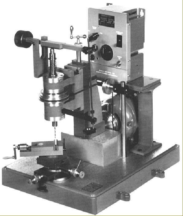 Derbyshire Micro Drill Press - The Derbyshire Micro Drill Press was designed for the drilling of very small holes, not as a regular drill for every-day work. Drill bits were held in standard, lathe-type collets. Note the vertical rod with finger rest used for applying sensitive drilling pressure.