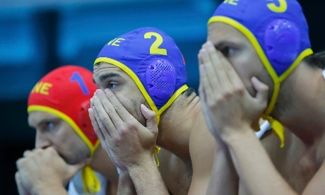 Montenegro's players look on in the final seconds of their team's loss to Croatia in their men's semifinal water polo match.