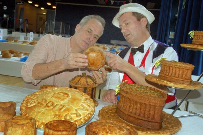 TV chef Phil Vickery (left) inspects the pork pies with Stephen Hallam, of Melton's Dickinson and Morris Ye Olde Pork Pie Shoppe, at the judging for the British Pie Awards EMN-170803-135644001