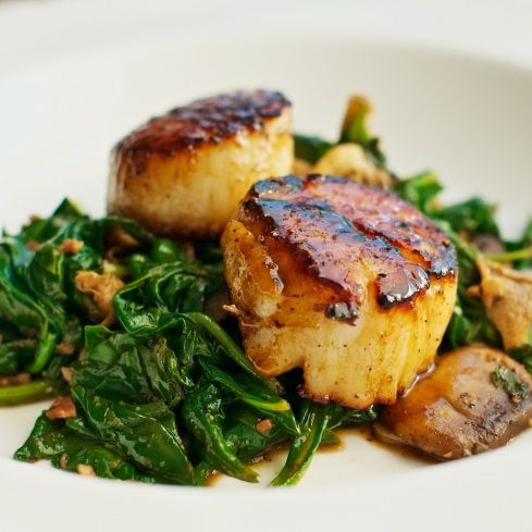 Seared scallops over spinach