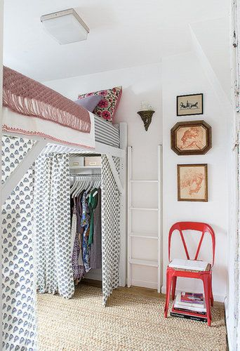 For unexpected clothing storage, raise your bed! Then, use the space below as a closet. Complete the look with curtains that add color yet keep your wardrobe out of site. Source: Domino Magazine