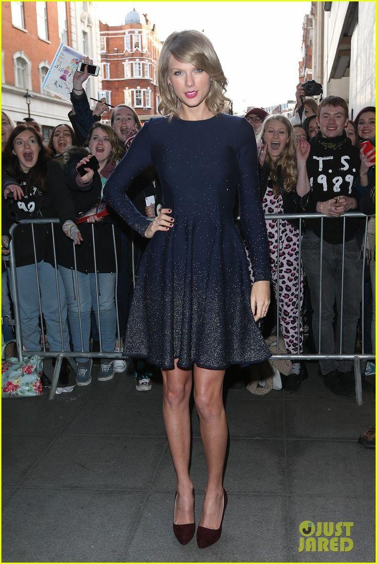 Taylor Swift in an Oscar De La Renta dress, Asos coat, and Prada shoes - Making a stop at BBC Radio 1 Studios.