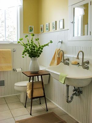 This small bathroom with white bead board, buttery wall color and the fabulous sink