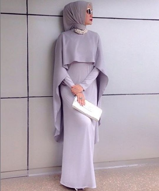 Classy gray dress combination with white hand bag and white accessories