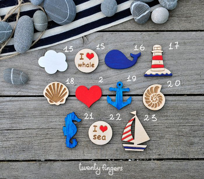 Lovely wooden brooch with sea motifs, set of 3 pieces - laser cut wood.   via Etsy.
