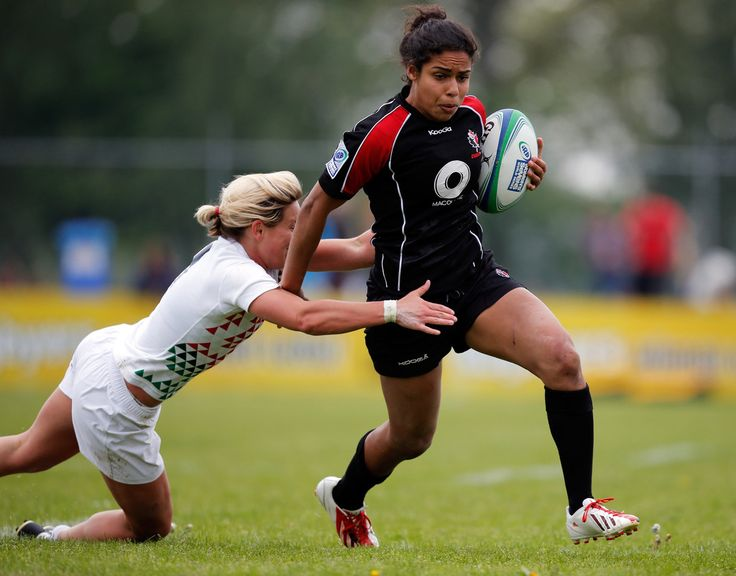 Magali Harvey of Canada is tackled by Claire Allan of England during the IRB Women's Sevens World Series match between England and Canada at the National Rugby Centre Amsterdam Sportpark de Eendracht on May 18, 2013 in Amsterdam, Netherlands.