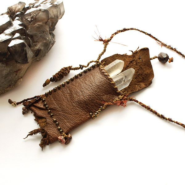 Pendant leather pouch for carrying crystals. Hahahahaha, I had to repin, and...why are we carrying crystals again!??