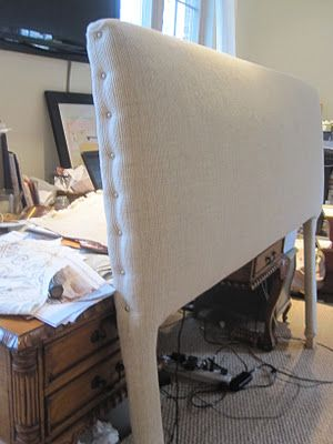 Make a fantastic Upholstered Headboard with this easy tutorial.