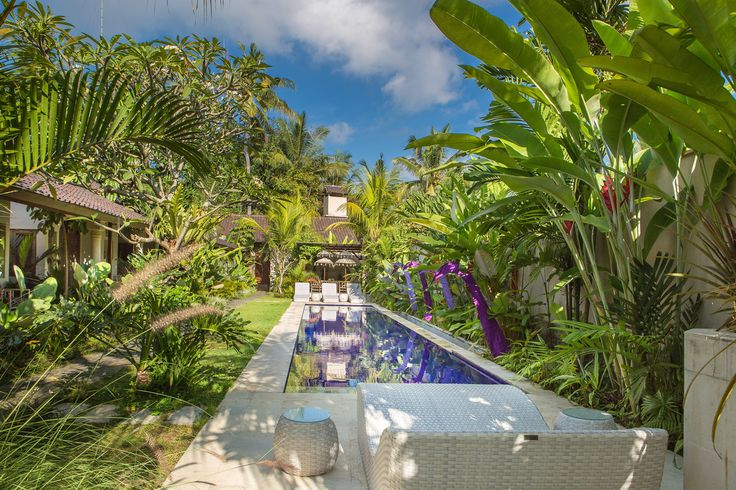 Villa Ahh's swimming pool is set in a gorgeous tropical garden.
