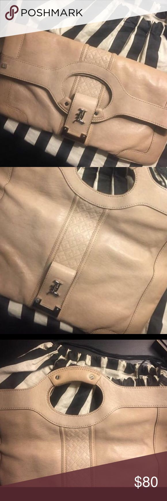 L.A.M.B. Original Leather clutch LAMB by Gwen Stefani leather clutch. Excellent condition comes with original dust bag.  Beige like color.  No stains.   * PLEASE CHECK MY OTHER ITEMS FOR SALE *  Thank You 😊  NOTE:  I also have matching LAMB pumps to go with the purse ladies!!!!  Check out my other items for sale!   Thank you!!! Bags Clutches & Wristlets