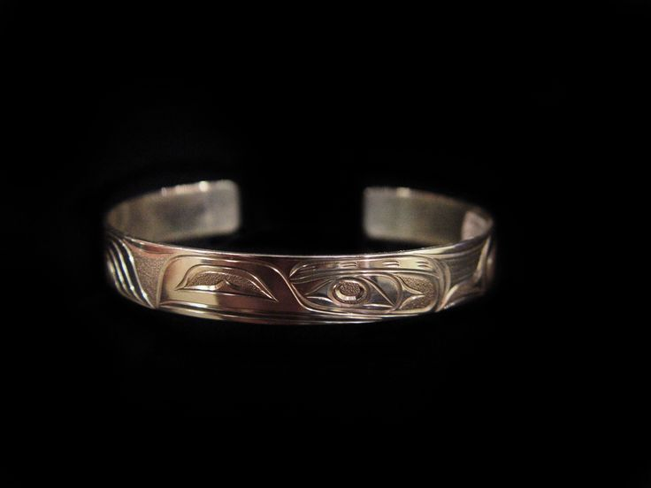 """Raven Bracelet, Joe Descoteaux. Hand carved sterling silver, 0.63"""". Northwest Coast First Nations Jewelry."""