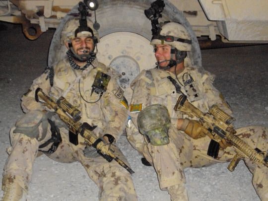Two Canadian soldiers rest after a patrol in Afghanistan