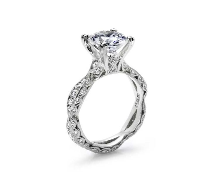 """Pricing Design Details Precious Metals A romantic """"twist"""" on the Tacori solitaire. A unique ribbon-twist band adds drama and glamour to a platinum shank, with crescent silhouette diamond details adding intrigue from every angle. Style # 2578RD9"""
