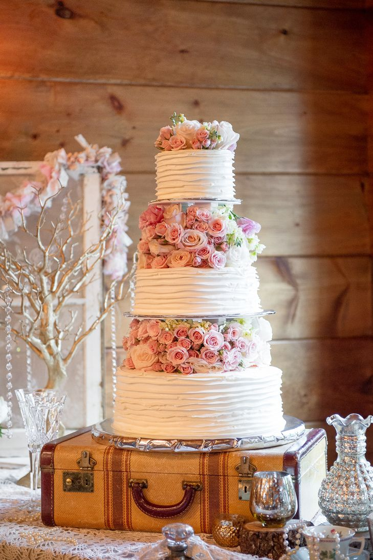Ruffled Wedding Cake Blush Floral Tiers | Paris Mountain Photography https://www.theknot.com/marketplace/paris-mountain-photography-rockmart-ga-197250 | Indigo Falls Events | Kelley Garner | A Perfect Wedding Floral Design https://www.theknot.com/marketplace/a-perfect-wedding-floral-design-rockmart-ga-433195
