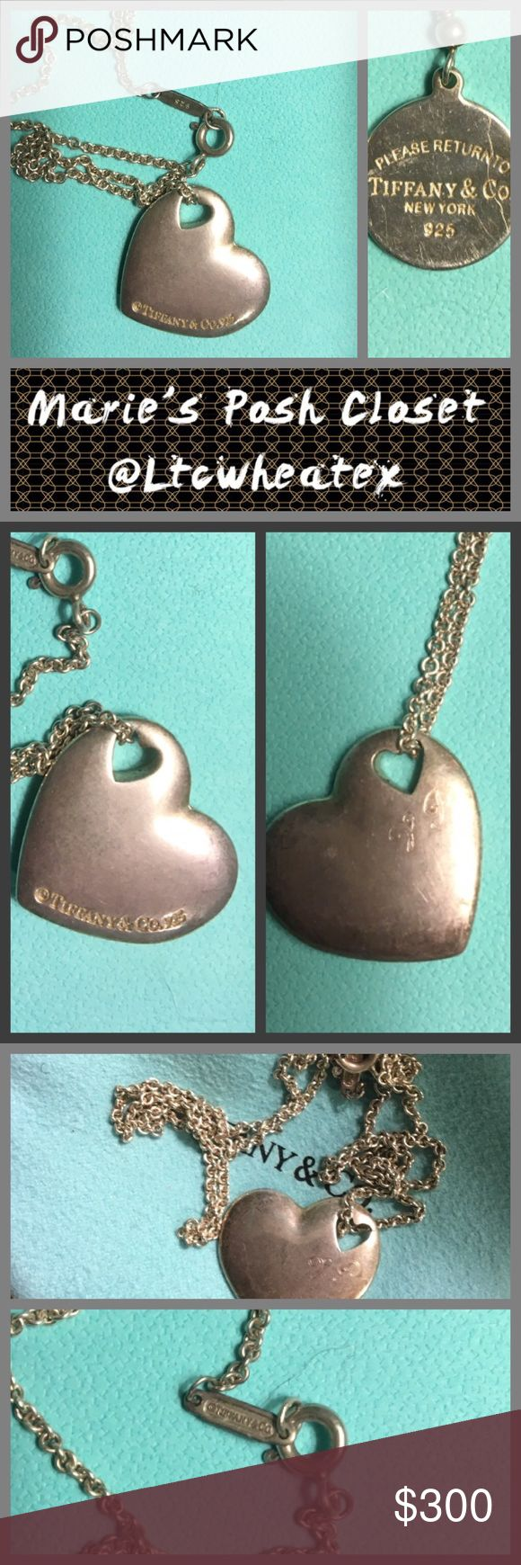 Tiffany's Necklace Silver chain with single heart charm in the classic Tiffany shape, but not flat. This heart has dimension. Heart has faint initials carved at the top but they're hard to see. They're not my initials as I bought this used. They didn't bother me so I never did anything about it but I'm sure you could have them removed by a competent jeweler if they bothered you. Dust bag included. Tiffany & Co. Jewelry Necklaces