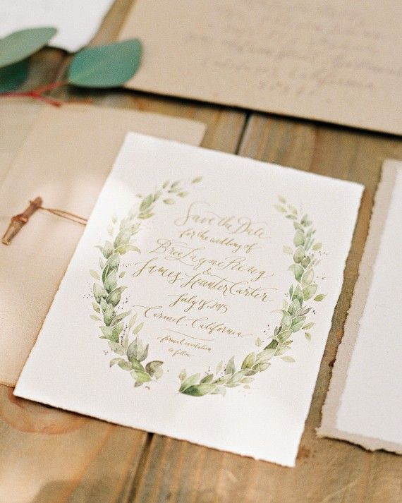 Watercolor and calligraphy save-the-dates, by Burbank's Tiny Pine Press, came wrapped in handmade kraft paper and sealed with a small twig.
