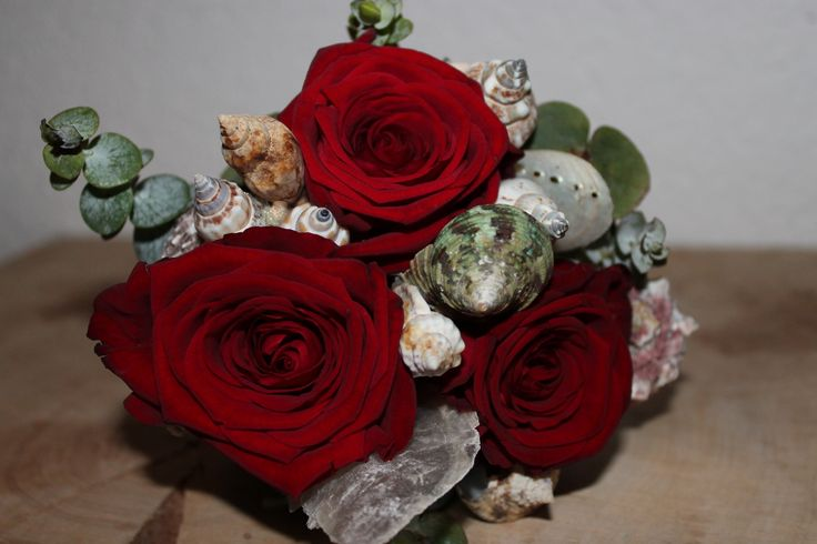 Wedding bouquet with roses and seashells