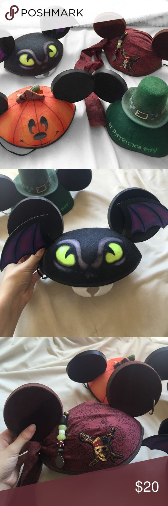 Set of 4 Themed Disney Mickey Ear Hats Includes 4 Disney Mickey hats • 1 Jack-o-lantern hat, 1 St. Patrick's Day hat, 1 Haunted Mansion hat with a bat with flapping wings, and 1 Jack Sparrow pirate hat • All will fit like a youth size except for the Jack Sparrow one, which is an adult size • Jack Sparrow hat has some wear and fading on one ear and the elastic band is stretched out. Minor fading on Jack-o-lantern hat Disney Accessories Hats