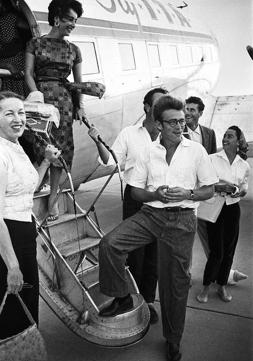 James Dean and Elizabeth Taylor board the plane to Texas for the filming of GIANT. (1955)