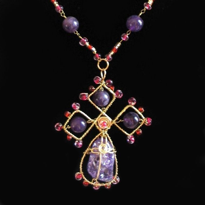 Custom made, one of a kind, amethyst cross, wire wrapped with pink glass beads to make this gorgeous pendant. Hand crafted by Kathy Stewart - Glam N Glitter Eclectic Jewelry.