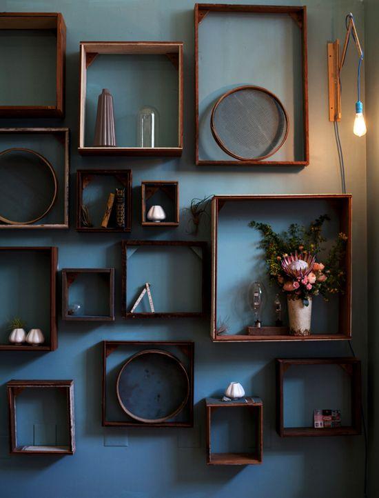 Wooden boxes as shelves.
