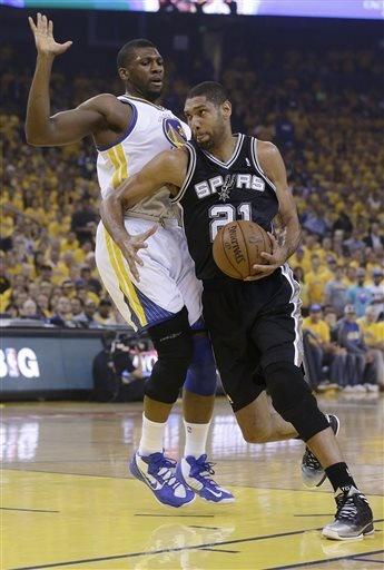 Tim Duncan (21) drives against Golden State Warriors center Festus Ezeli
