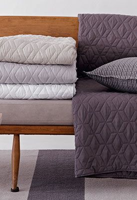 Cube Quilted Coverlets. http://www.lovelylinen.co.za/product-category/coverlets/