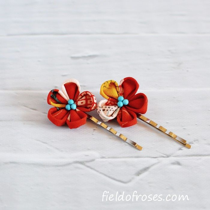 "A set of tsumami kanzashi style bobby pins is made from vintage silk kimono and decorated with chalk turquoise beads. The flower is approx. 1 1/8""(3.2cm) . Each hand folded petal is made from beautifu"