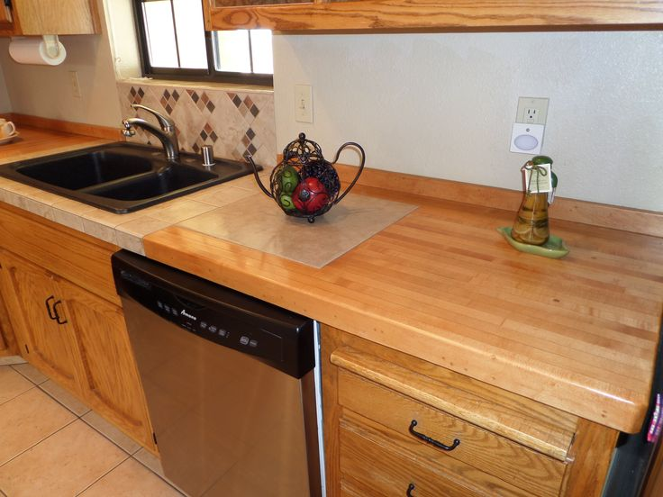 Refurbished countertops using old rock marble bowling for Types of countertops for kitchen
