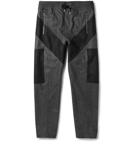 Givenchy has a knack for transforming wardrobe classics into something infinitely more progressive and stylish. Take these grey wool-flannel trousers - they're finished with contrasting charcoal patches, offering a hit of contemporary cool. The drawstring waist and zipped cuffs allow you to personalise the fit. Try yours with a clean-cut polo shirt and sneakers.