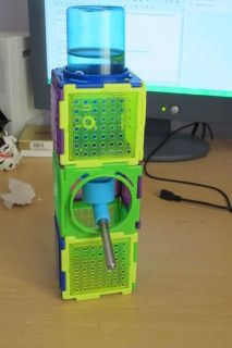 Making a water bottle stand out of hamster Puzzle Playground pieces