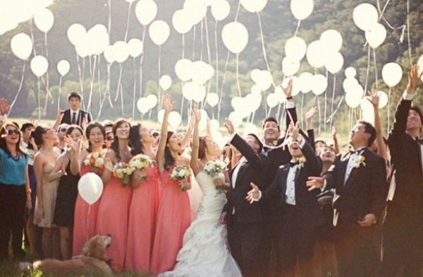Releasing balloons is an awesome idea at the end of the ceremony since we are having the reception at the same location and there won't be an exit.