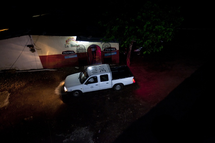 """A taxi pulls up to """"La Noche"""" brothel on San Cristobal Island in the Galapagos one night to take a patron home after his evening with one of the prostitutes. Each prostitute has an average of 30 clients in a week at """"La Noche,"""" but at other brothels on the mainland, she can have 30 clients in one night. Kathryn Carlson/reesenews"""