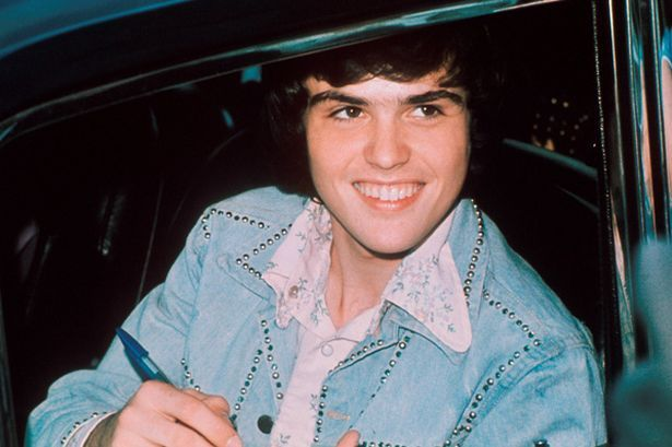 Donny Osmond of The Osmonds, signing autograph, London, 1975.