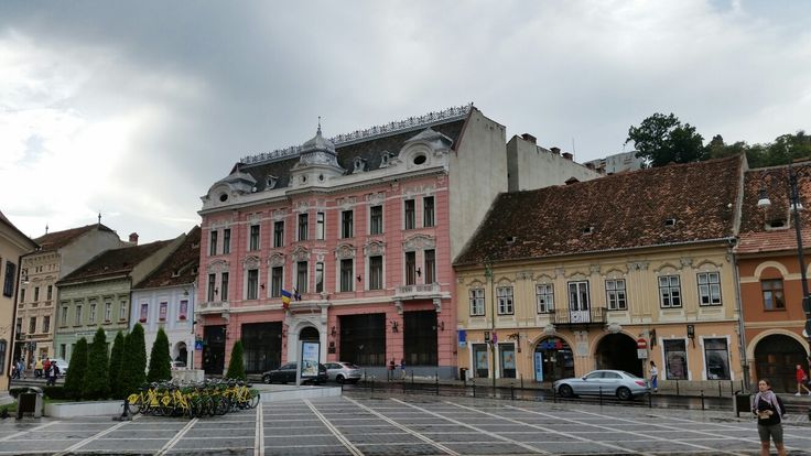 "Traditional German houses on the border of ""Piata Sfatului"" located in the city center of Brasov, Transylvania, Romania.  Now they house shops, restaurants and coffeshops > #trivo #brasov #piatasfatului #romania #transilvania"