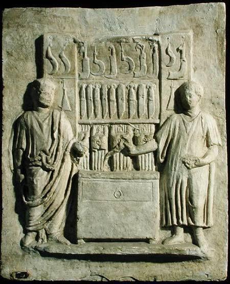 Relief depicting a cutlery shop (stone), Roman, (2nd century AD) / Museo della Civilta Romana, Rome, Italy.