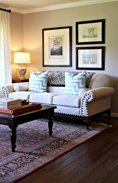 rug and table combination, chunky scatter cushions (minus the throw over couch's back, and minus unbalanced frames)