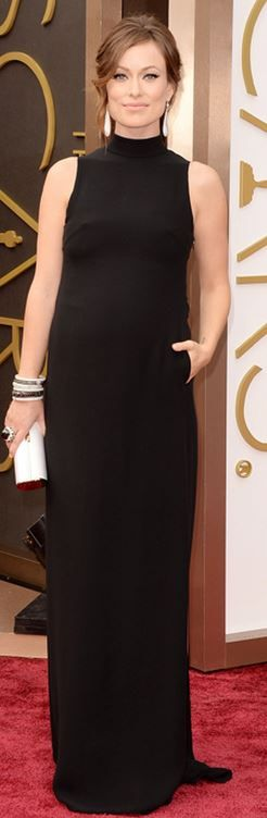 Who made Olivia Wilde's black gown, clutch handbag, and jewelry that she wore to the 2014 Oscars?