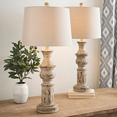 Our Distressed Cream Table Lamps feature effortless rustic style. These matching lamps are perfect for flanking your bed and bringing farmhouse flair to your bedroom.